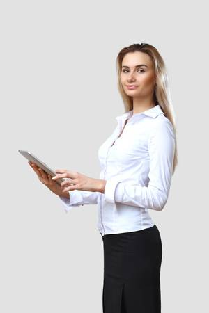 POrtrait of a young beautiful woman in business wear at work photo