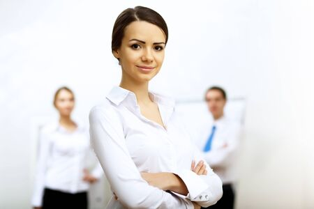 Portrait of a business woman in office environment photo