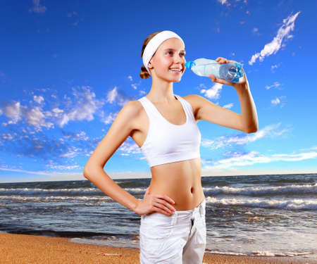 Young healthy and fit woman doing sport Stock Photo - 13382773