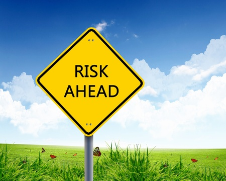 Picture of yellow road sign warning about risk ahead Stock Photo - 13382855