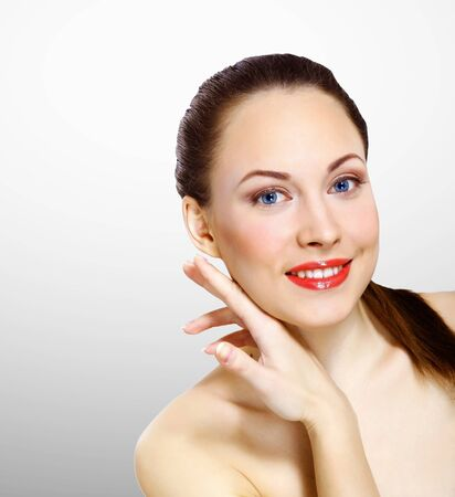 Studio portrait of young beautiful woman natural look photo