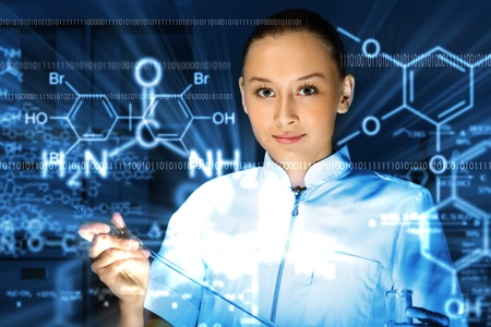 Young chemist in white uniform working in laboratory Stock Photo - 13382856
