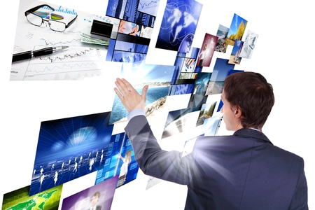 Man working with vurtial screens with different images Stock Photo - 13383204