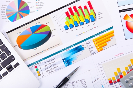 business report: Graphs, charts, business table. The workplace of business people. Stock Photo