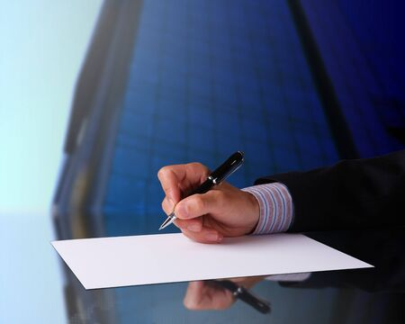 Image of a businessman hand signing documents photo
