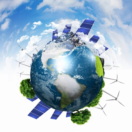 clean energy: Green planet earth with solar energy batteries installed on it Stock Photo