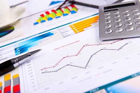 Financial paper charts and graphs on the table Stock Photo - 13956261