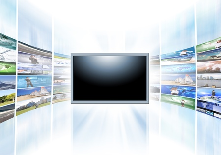 A flat screen television has a blank black text area with photo images coming out of the sides of it  The tv has a glowing light coming out the top