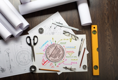 Tools and papers on the table with financial symbols photo