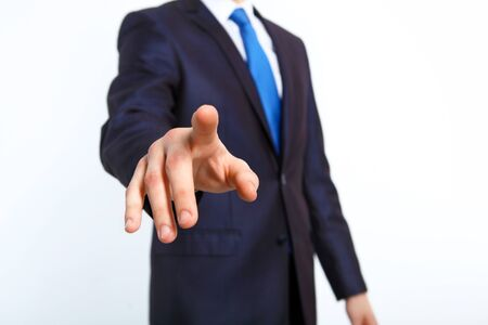 Business man in suit pushing a button with his finger photo