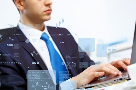 Business person working on computer against technology background Stock Photo - 14026779