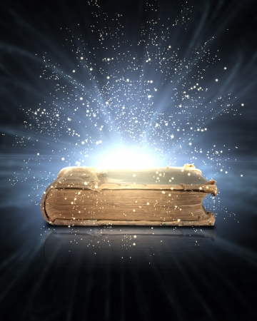 ethereal: Magic book with light coming from inside it Stock Photo