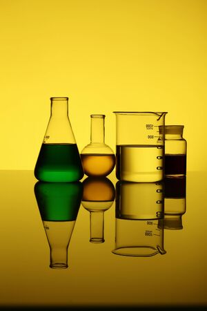 Glass chemistry tubes on a colour background photo