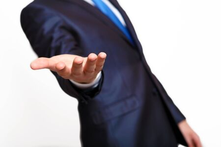 An empty hand of a businessman in blue suit Stock Photo - 14038738