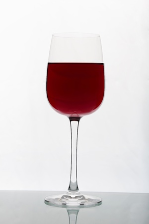 Glasses with wine on the color background Stock Photo - 14038670