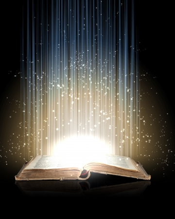 magic book: Magic book with light coming from inside it Stock Photo