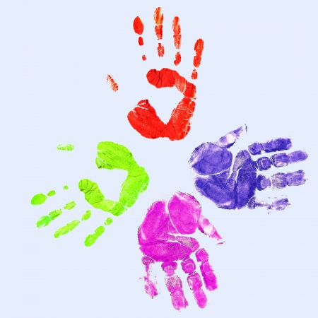 Colourful prints of human hands on white background photo