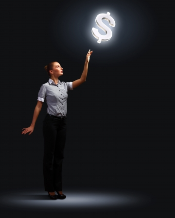 Light bulb and a business person as symbols of creativity in business Stock Photo - 14050684