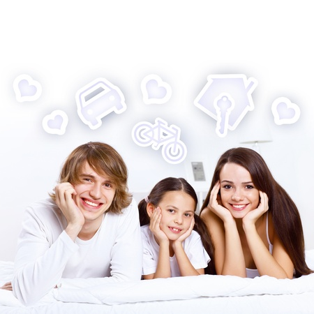 Young family with a daughter andheart symbols photo