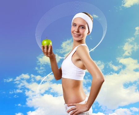 Portrait of a young woman doing sport with a bottle of pure water photo