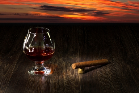 Image with a glass of cognac and cigar photo