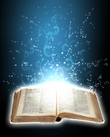 turning page: Magic book with light coming from inside it Stock Photo