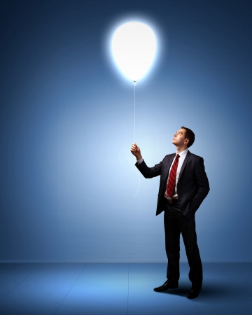 Light bulb and a business person as symbols of creativity in business Stock Photo - 14057126