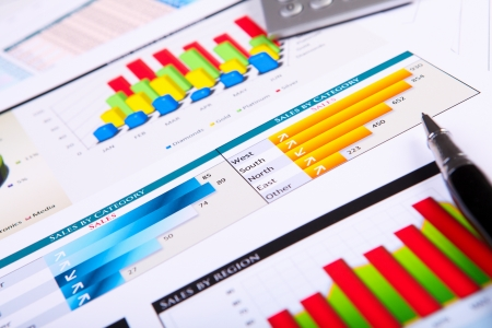 Financial paper charts and graphs on the table Stock Photo - 14057343