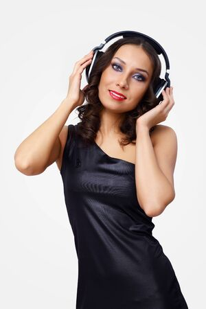 Portrait of young woman with headphones in studio photo