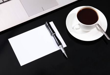 White cup with black coffee at business workplace photo