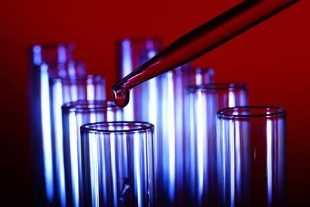 Glass chemistry tubes on a colour background Stock Photo - 14061701