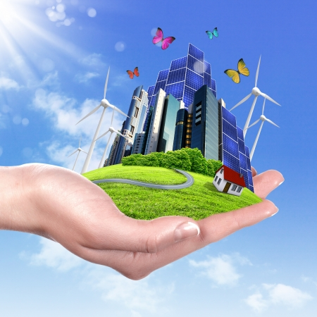 save environment: Hands holding a green earth with solar batareis Stock Photo