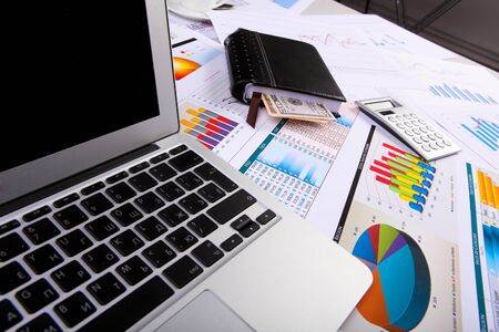 Financial paper charts and graphs on the table Stock Photo - 14067691