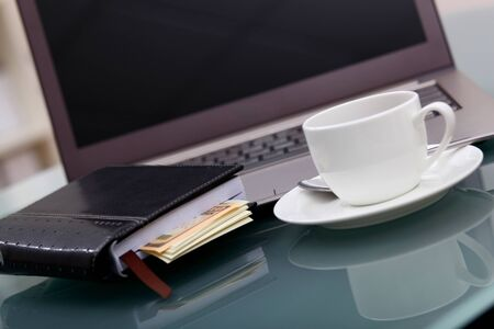 Image of business table with a cup of coffee and norebook Stock Photo - 14067766