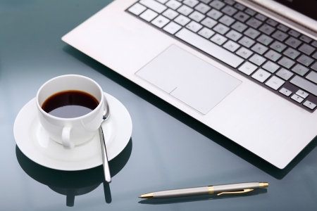 Image of business table with a cup of coffee and norebook Stock Photo - 14067764