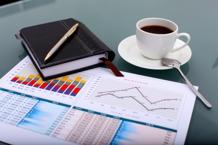 Image of business table with a cup of coffee and norebook Stock Photo - 14067772