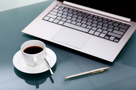 office break: Image of business table with a cup of coffee and norebook