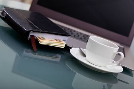 Image of business table with a cup of coffee and norebook Stock Photo - 14057157