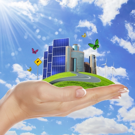 Hands holding a green earth with solar batareis Stock Photo - 14068614
