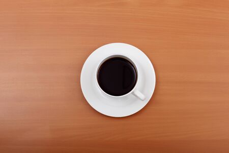 Cup of black coffee in a white cup photo