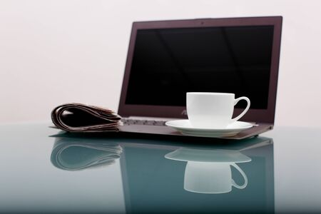 Image of business table with a cup of coffee and norebook Stock Photo - 14080797