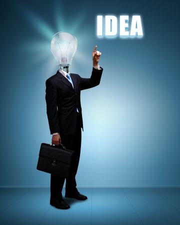inspiration education: Light bulb and a business person as symbols of creativity in business