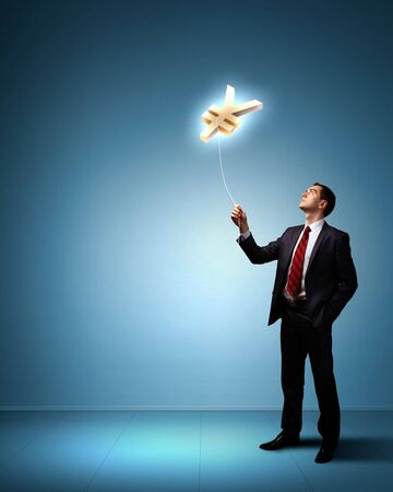 Light bulb and a business person as symbols of creativity in business Stock Photo - 14080403