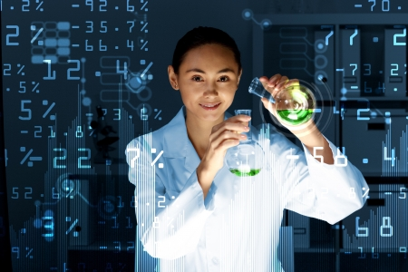 laboratories: Young scientist in laboratory in white uniform