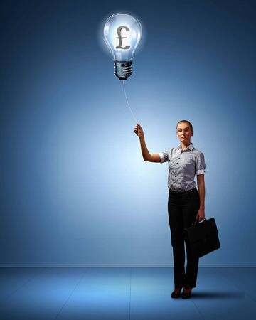 Light bulb and a business person as symbols of creativity in business Stock Photo - 14106949