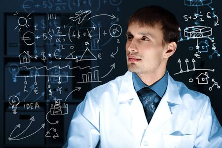 Young scientist in laboratory in white uniform photo