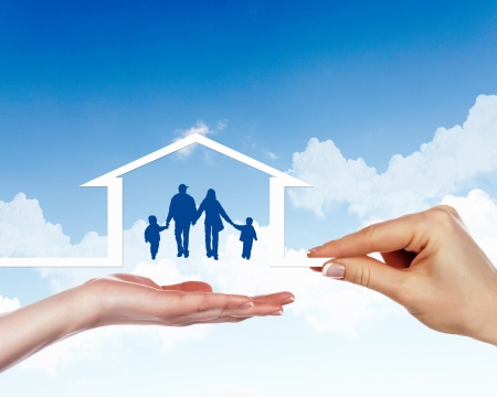 house in hand: Family of parents and two children inside a house Stock Photo