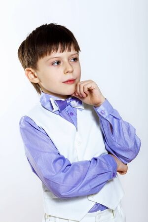Portrait of a little boy dressed for a celebration photo