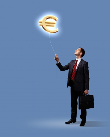 Light bulb and a business person as symbols of creativity in business photo