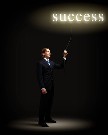 Light bulb and a business person as symbols of creativity in business